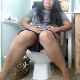 A plump, mixed-Asian girl wearing glasses sits down on a toilet while suffering from stomach cramps, After some pushing, a gassy, crackling poop is heard coming out. Some pissing, too. Presented in 720P HD. About 4 minutes.